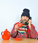 Ill Man with Red Teapot making a Phonecall