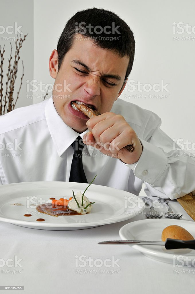 Ill Manered Teen in Fancy Restaurant stock photo