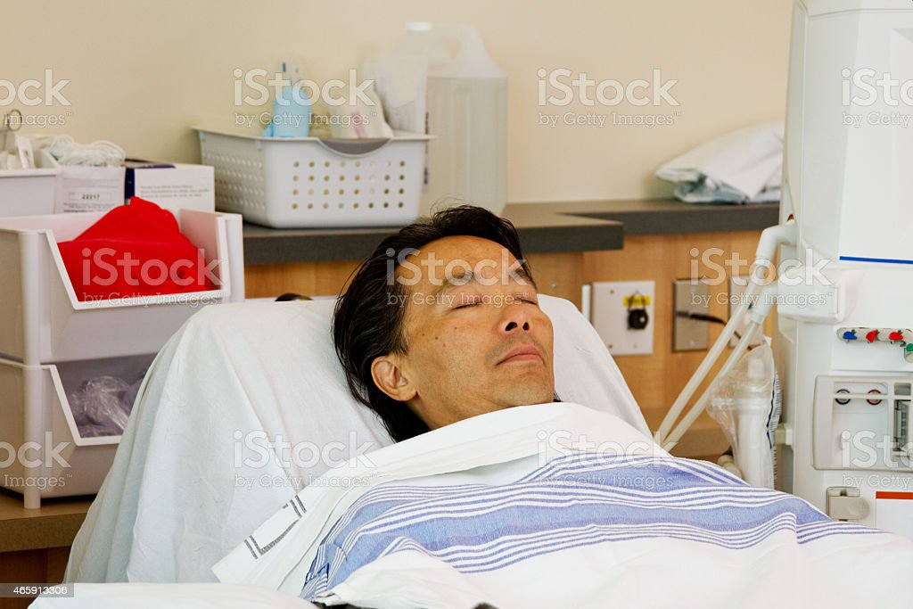 Ill patient on stretcher ready for dialysis stock photo