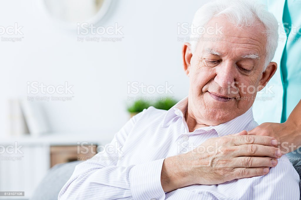 Ill senior amn with support stock photo