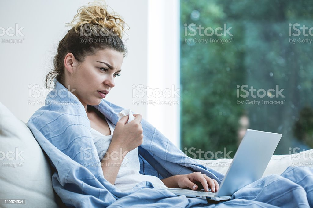 Ill woman and laptop stock photo