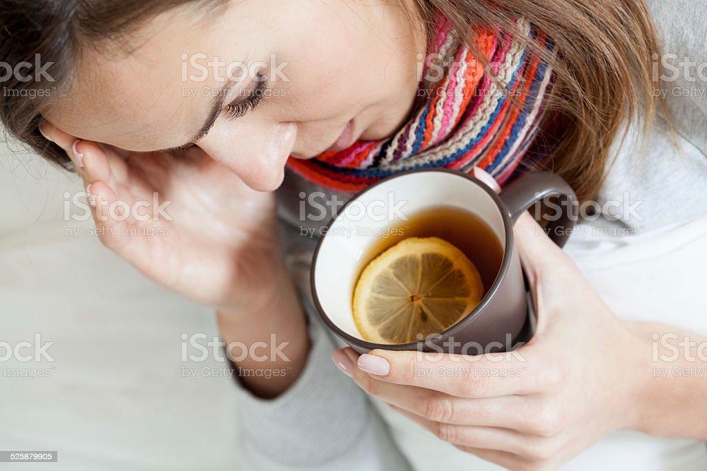 Ill woman drinking tea stock photo
