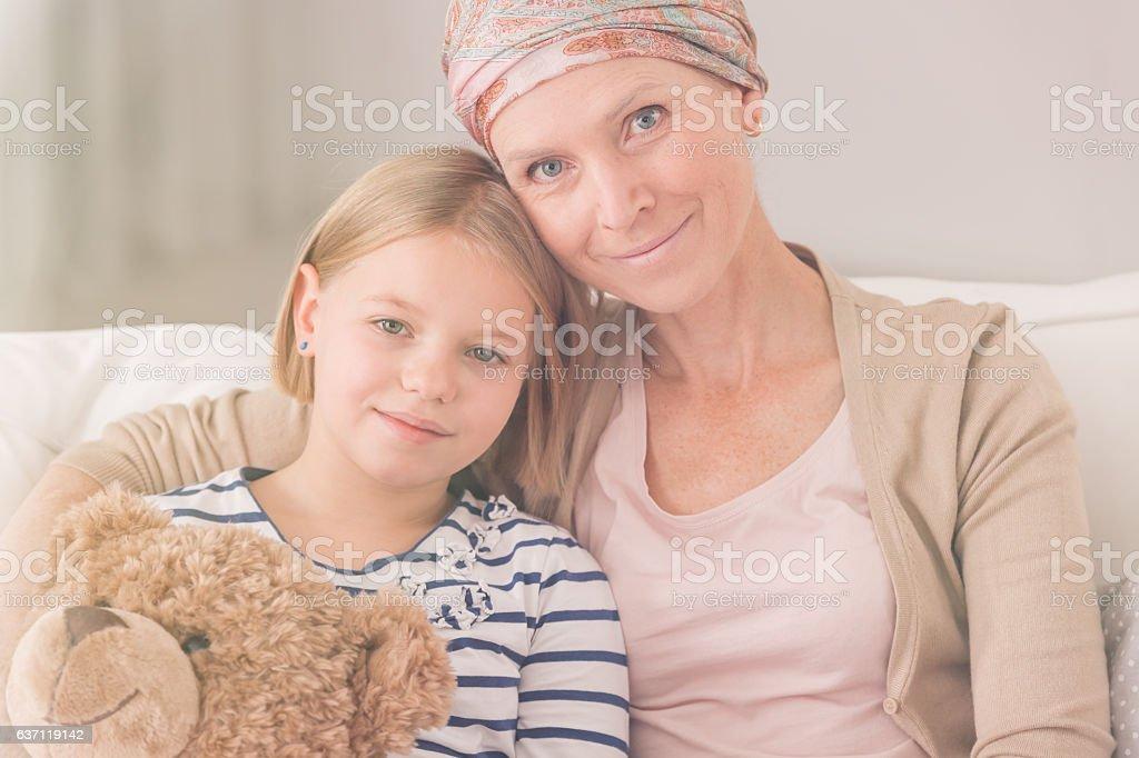 Ill woman embracing child stock photo