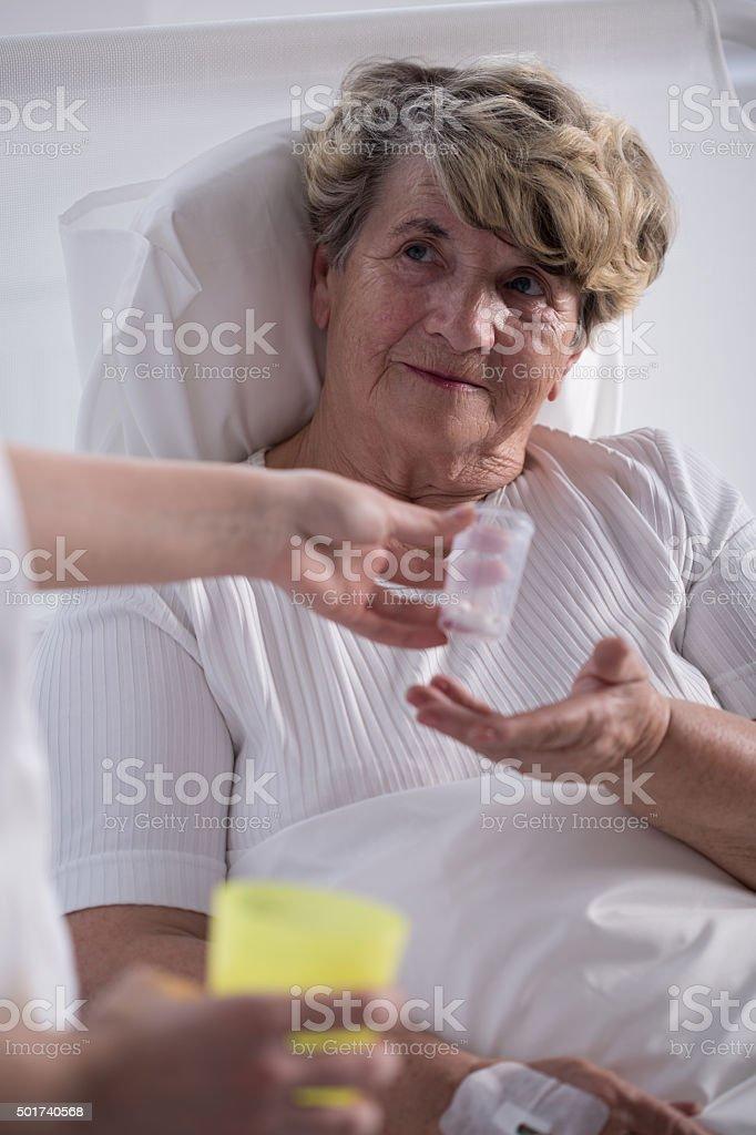 Ill woman taking medicines stock photo