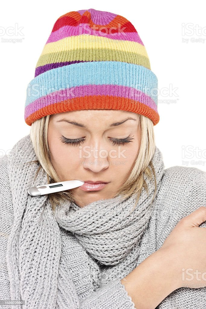 Ill woman with thermometer in her mouth royalty-free stock photo