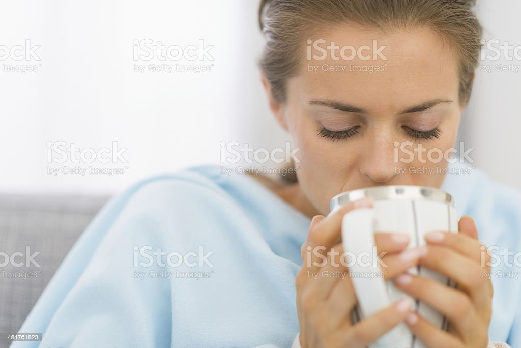 ill young woman drinking hot beverage royalty-free stock photo
