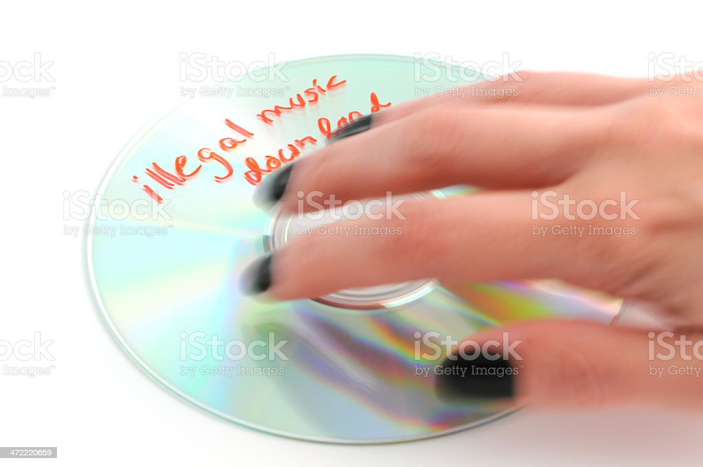illegal music download on cd rom stock photo