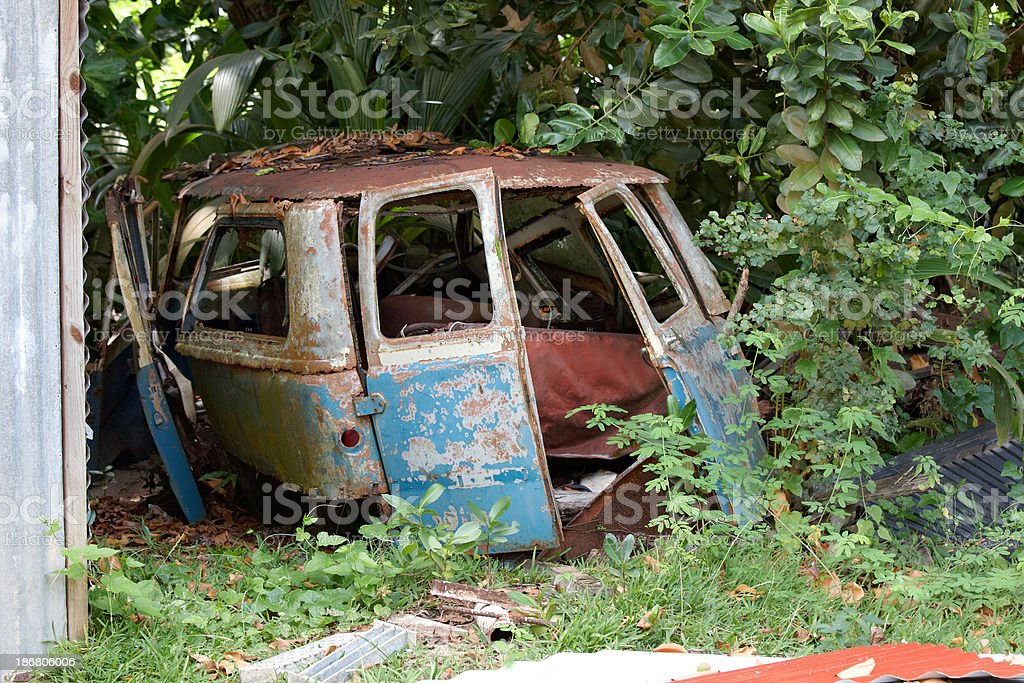 illegally dumped rusty car royalty-free stock photo