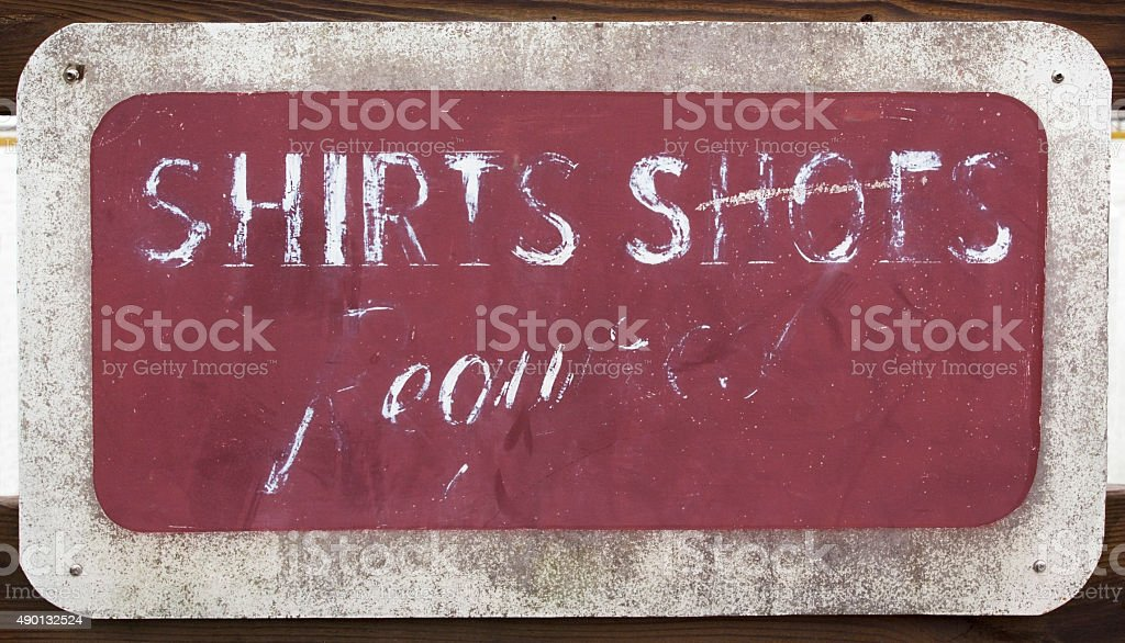 Illegible Shirts and Shoes Required Sign stock photo