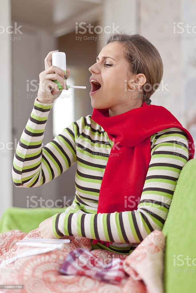 illness woman uses spray royalty-free stock photo