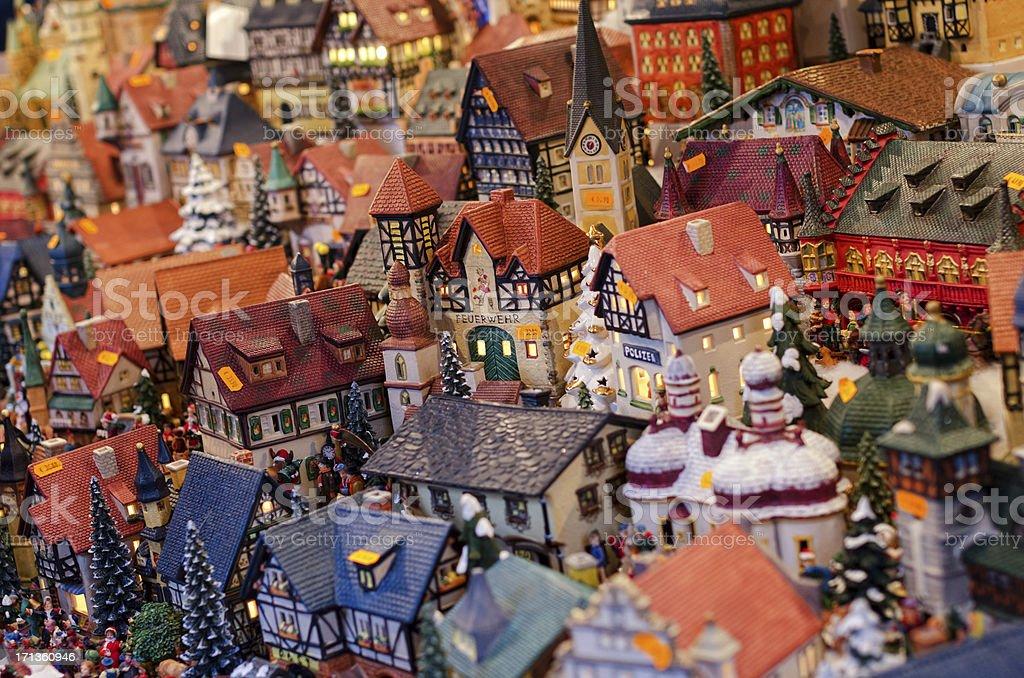 Illumiated miniature houses at German Christmas Market royalty-free stock photo