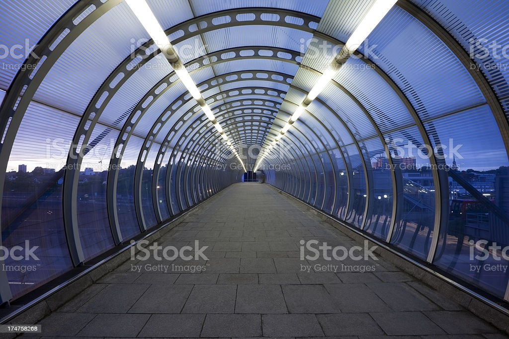 Illuminated Abstract Glass Skywalk at Dusk, London, UK stock photo