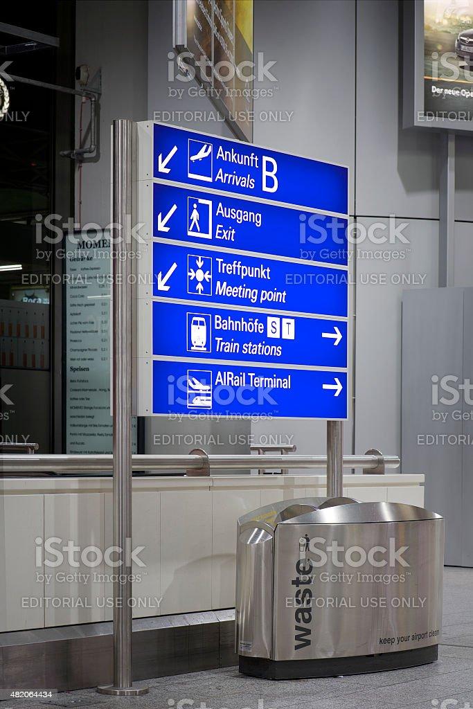 Illuminated airport sign at night stock photo