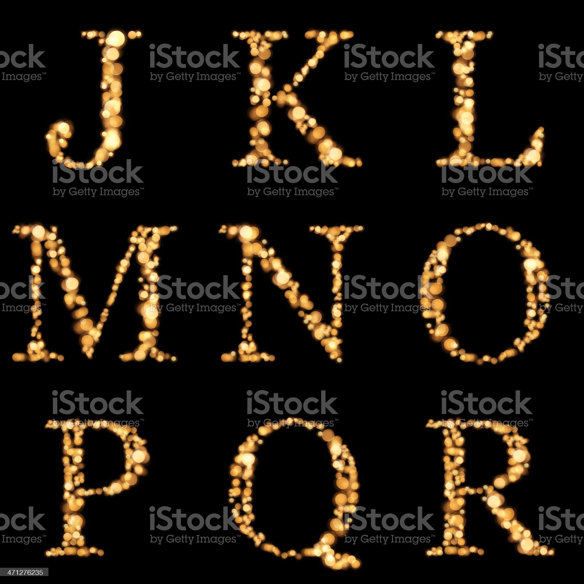 Illuminated alphabet of yellow defocused lights J-R royalty-free stock photo
