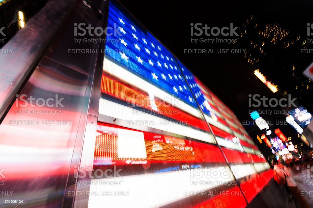 Illuminated American Flag in Times Square NYC at Night stock photo