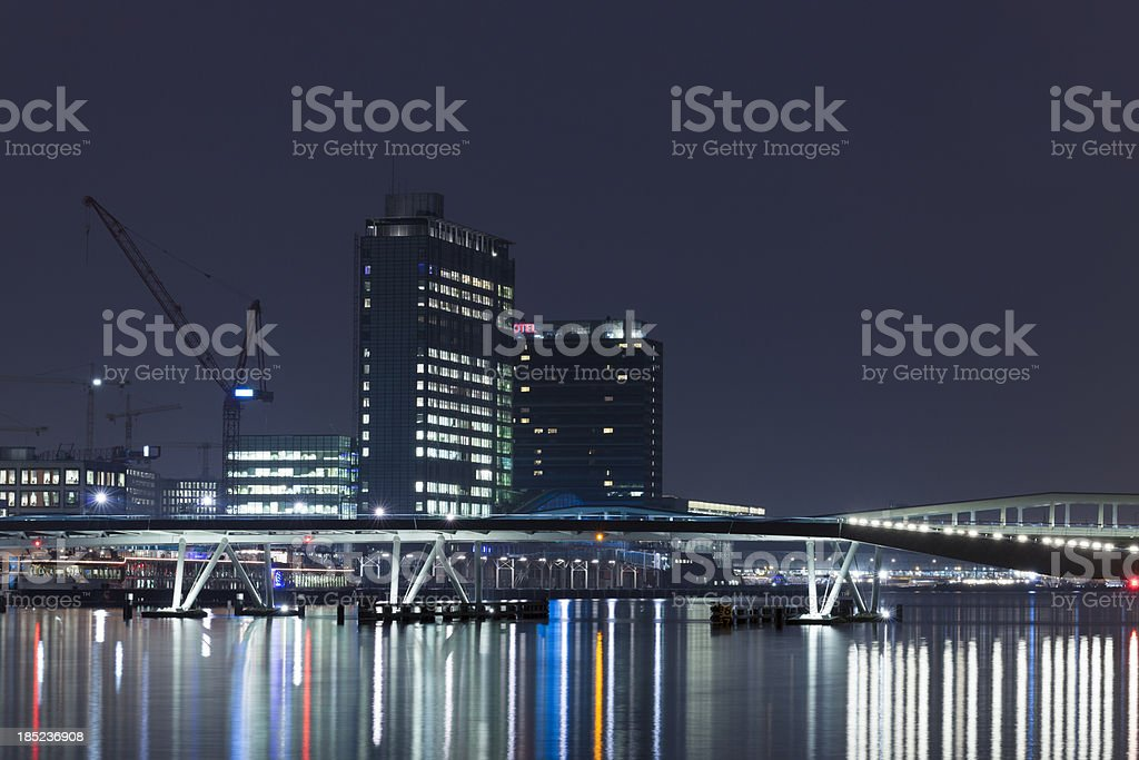 Illuminated Amsterdam waterfront skyline. royalty-free stock photo