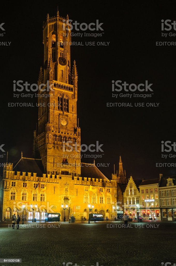 Illuminated Belfry Tower in the Old Town of Bruges, Belgium stock photo