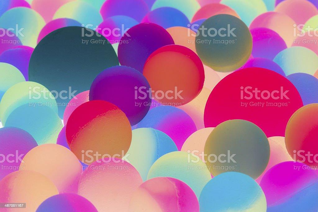 Illuminated bicolor balls background stock photo