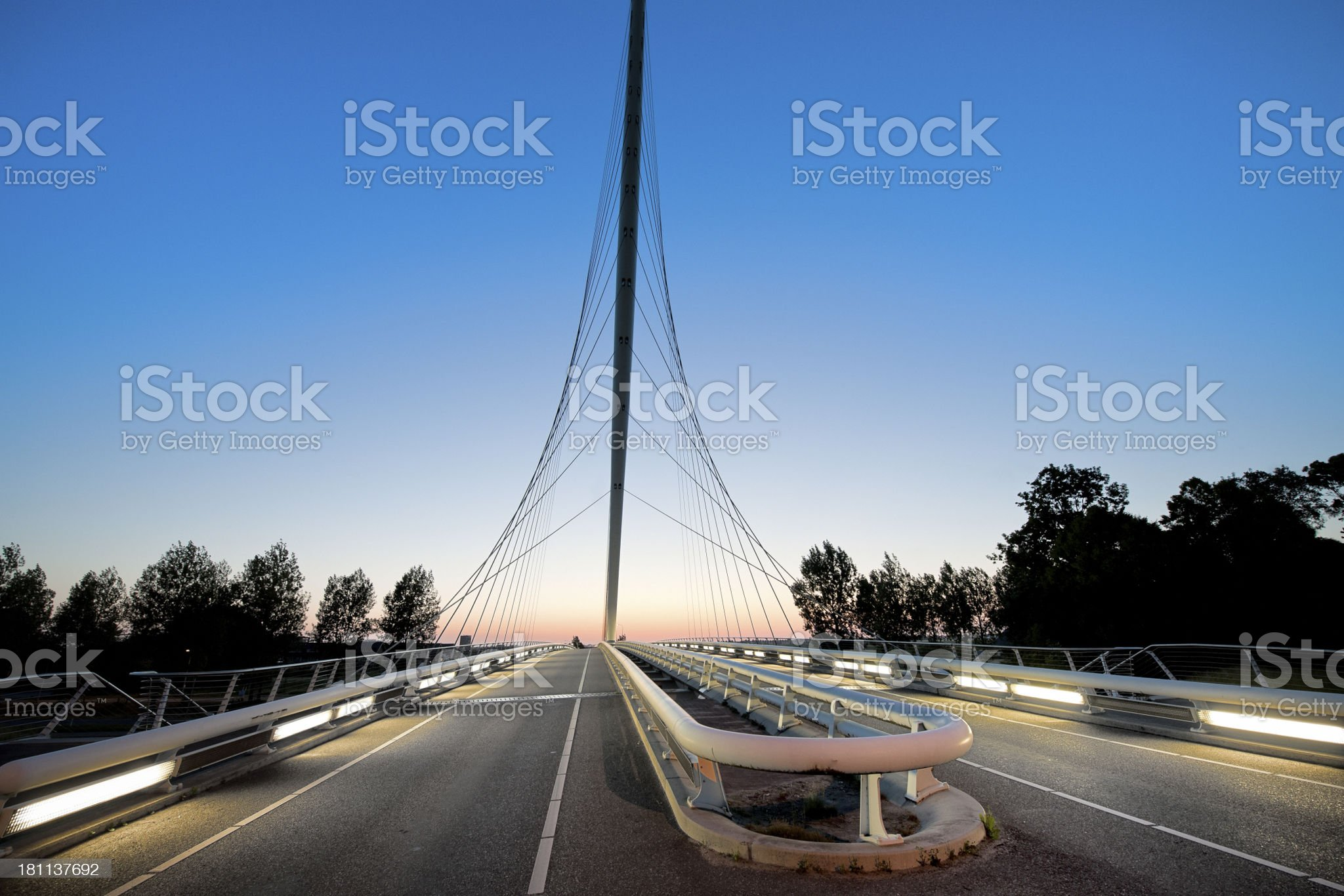 illuminated bridge at sunset royalty-free stock photo