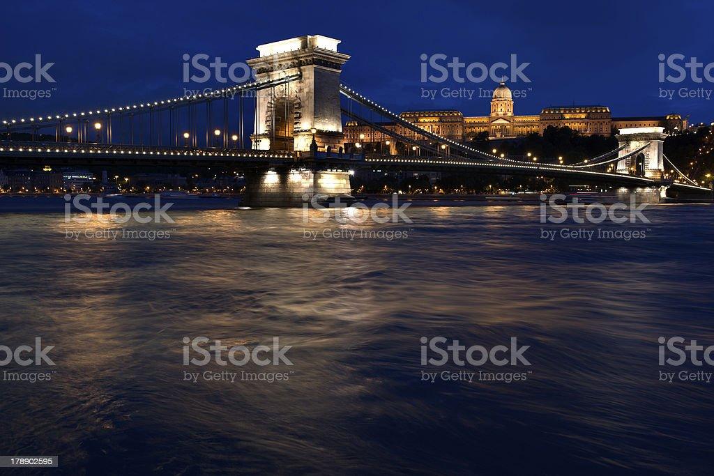Illuminated bridge crossing Danube River, Budapest, Hungary royalty-free stock photo