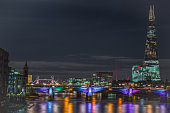 Illuminated bridge over the Thames river. London in the night.