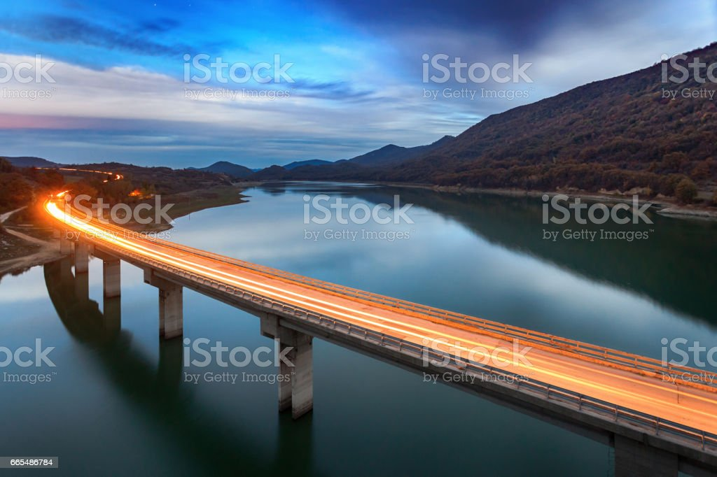 Illuminated bridge way over a lake stock photo