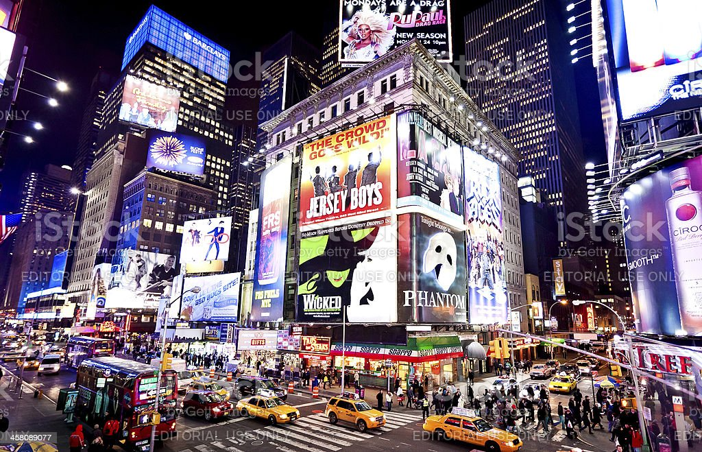Illuminated Broadway theatres on Times Square stock photo