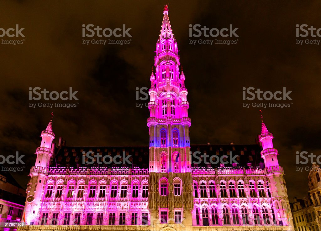Illuminated Brussels Town Hall at the Grand Place at night stock photo