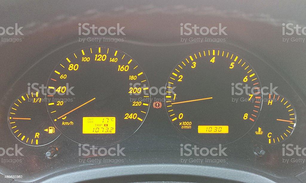 Illuminated car instruments on dashboard stock photo