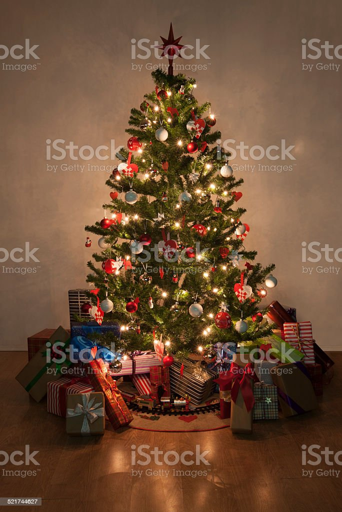 illuminated christmas tree with presents stock photo