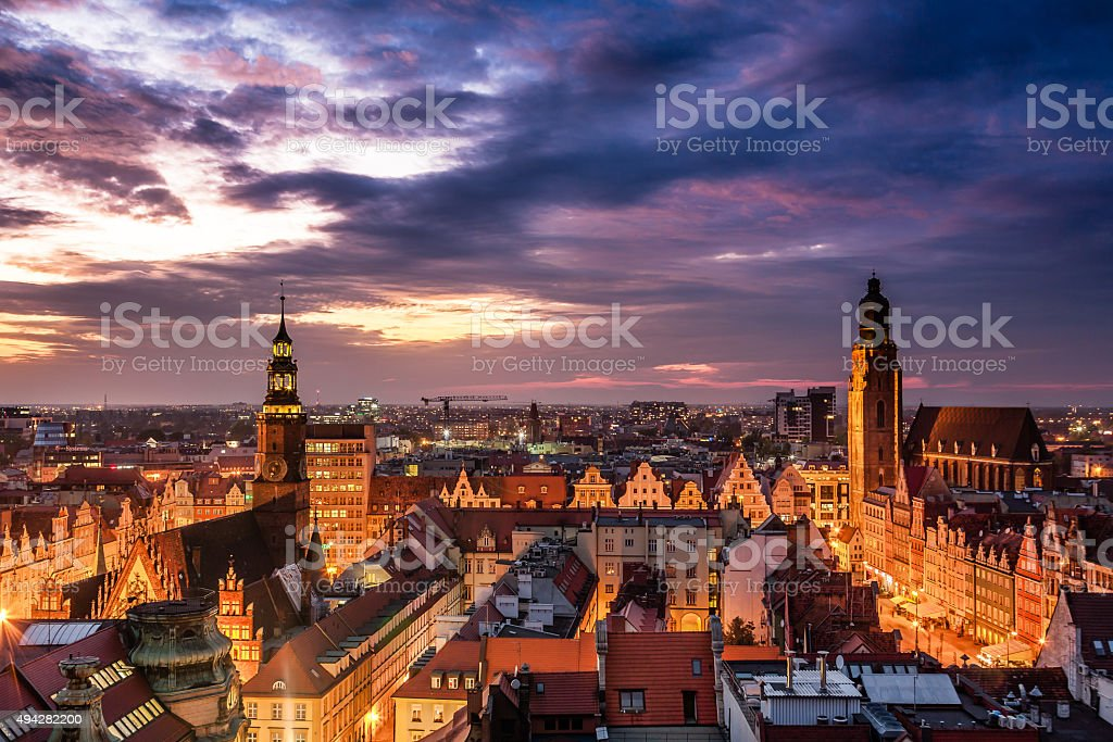 Illuminated city skyline at night stock photo