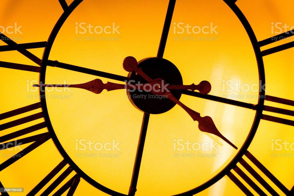 Illuminated clock face stock photo