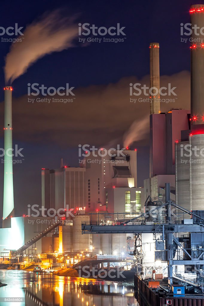 Illuminated Coal-Fired Power Plant at Night, Germany stock photo