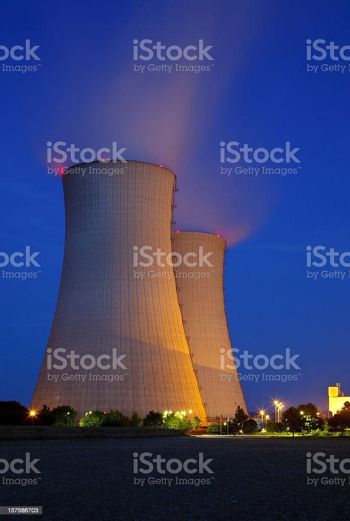 Illuminated Cooling Towers At Night stock photo