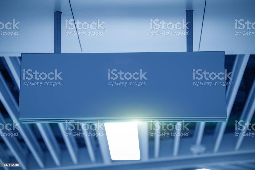 Illuminated Corporate Office Exit Sign Closeup. stock photo