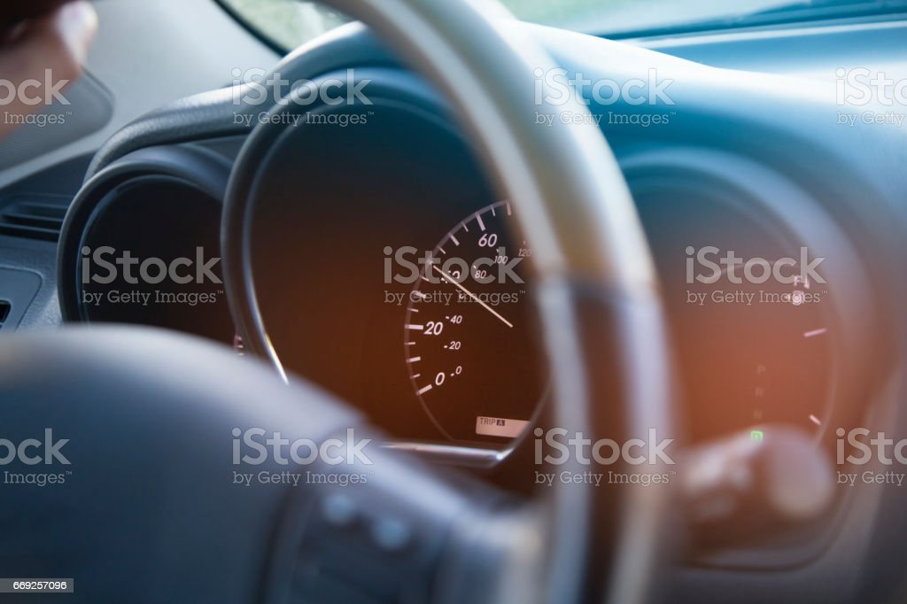 Illuminated dashboard and steering wheel of a modern car stock photo