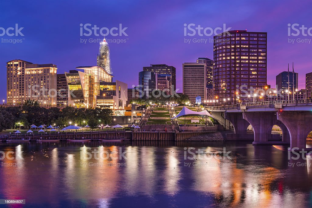 Illuminated downtown Hartford, Connecticut skyline at dusk stock photo