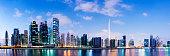 Illuminated Dubai city skyline at sunset, United Arab Emirates.