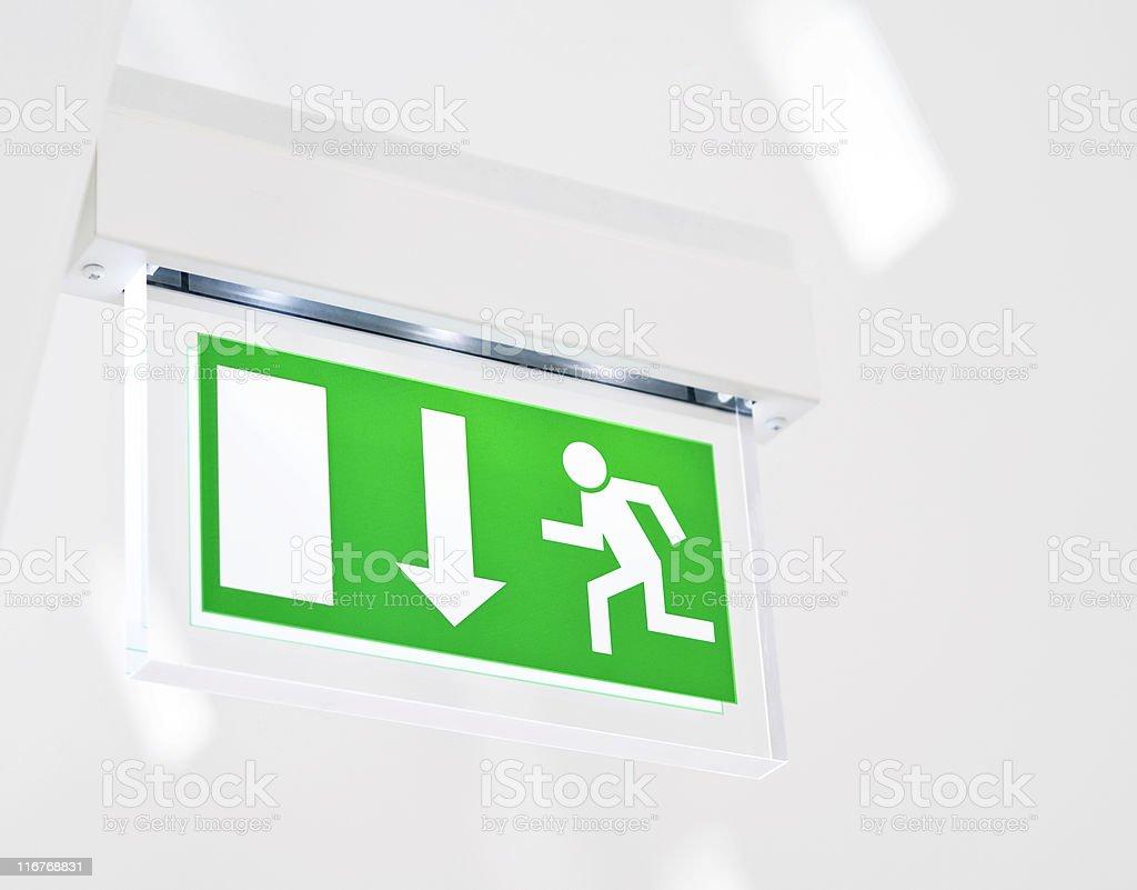 Illuminated emergency exit sign royalty-free stock photo