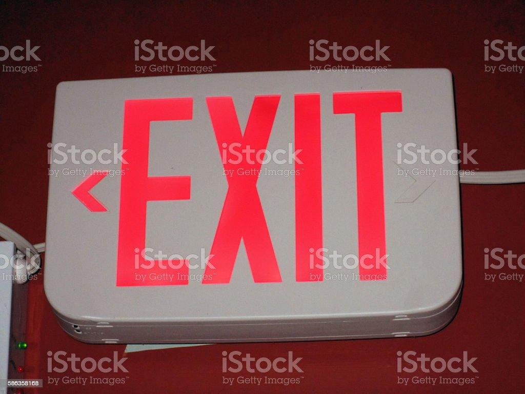 Illuminated Emergency  Exit Sign stock photo