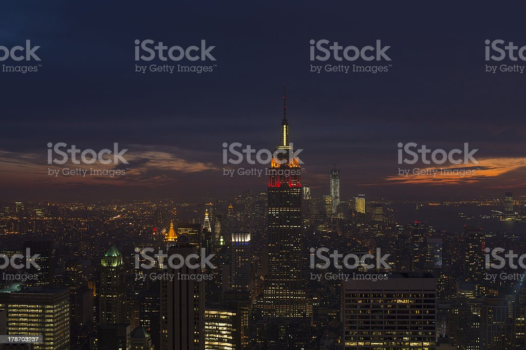 Illuminated Empire State and New York's skyline at dusk royalty-free stock photo