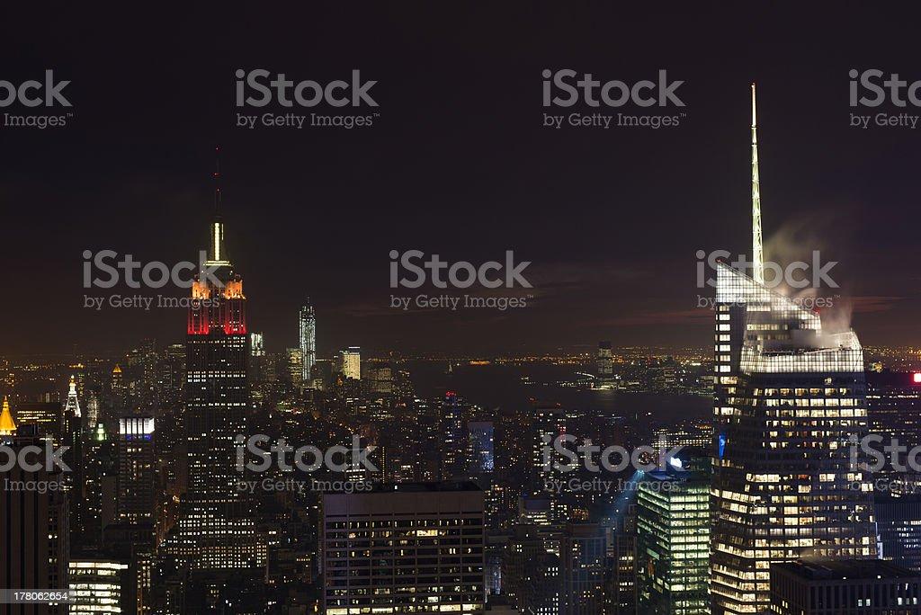 Illuminated Empire State and New York's skyline at night royalty-free stock photo