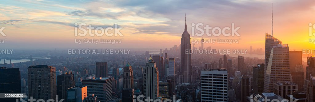 Illuminated Empire State and New York's skyline at night stock photo