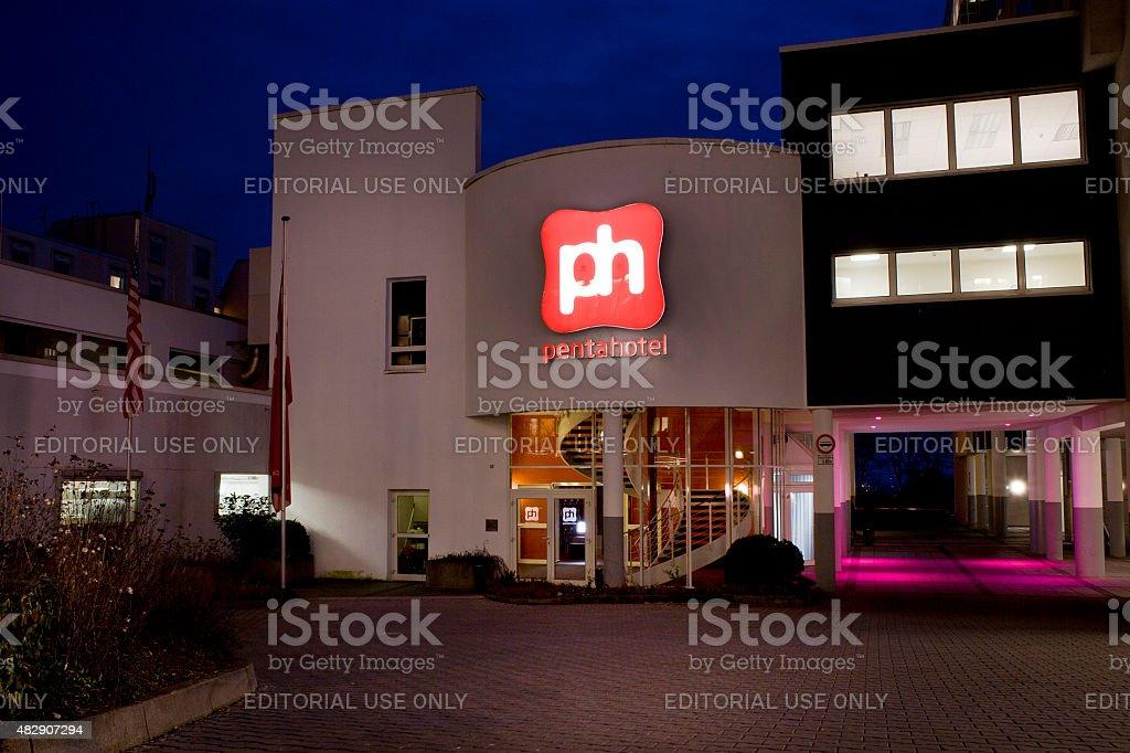 Illuminated entrance of Pentahotel stock photo