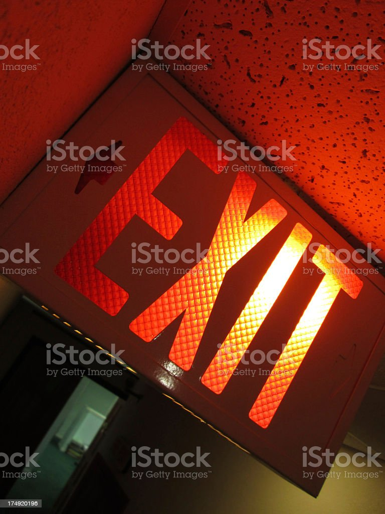 illuminated exit sign in dark indoors royalty-free stock photo