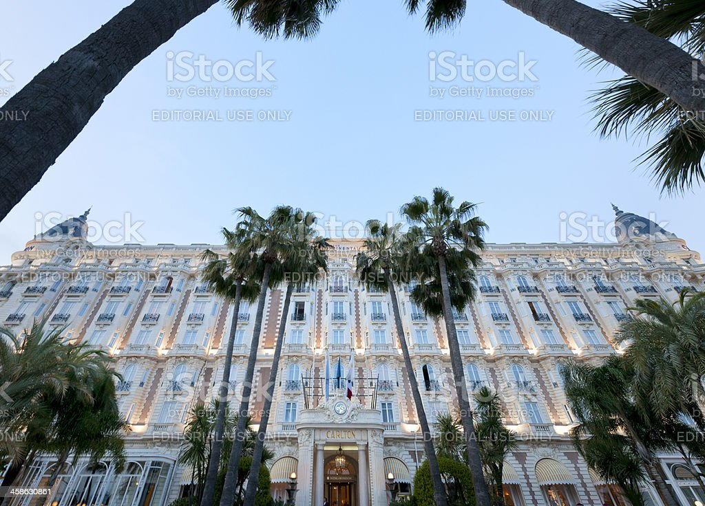 illuminated facade of the InterContinental Carlton Cannes hotel at dusk stock photo