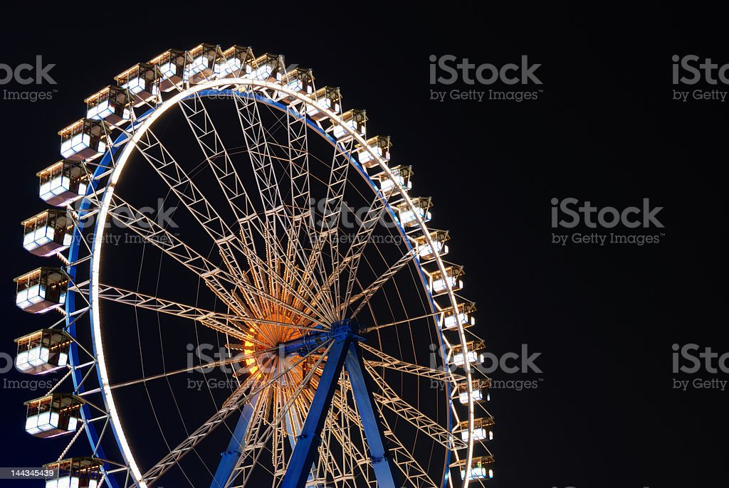 illuminated ferris wheel at night against dark sky royalty-free stock photo