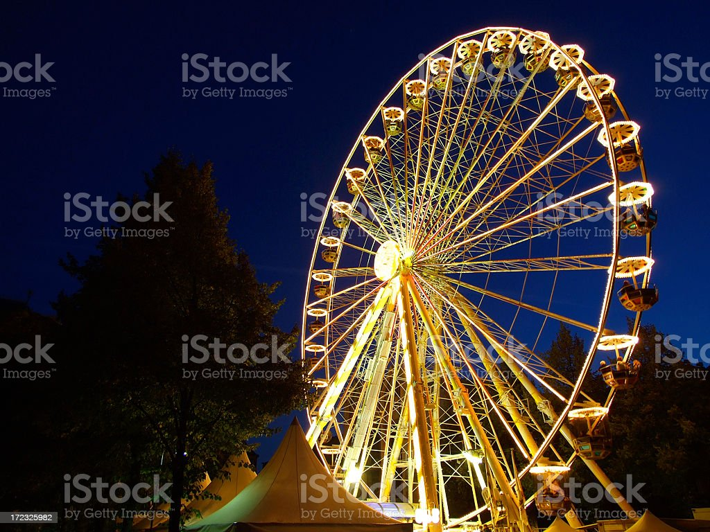 Illuminated Ferris Wheel at night royalty-free stock photo