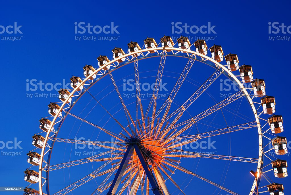 illuminated ferris wheel at twilight royalty-free stock photo