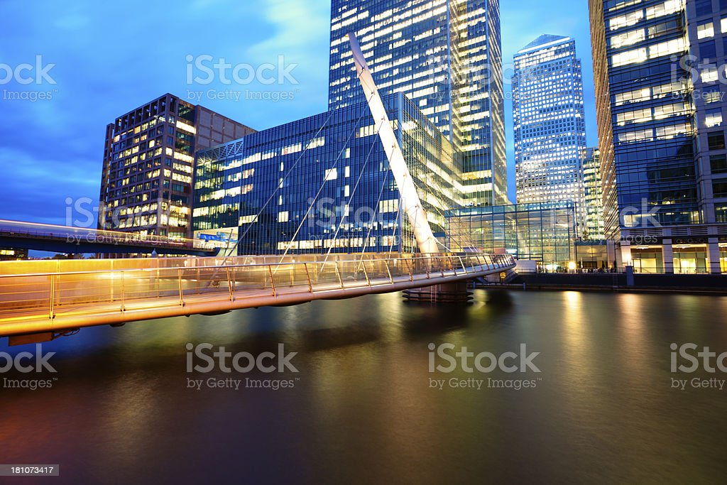 Illuminated Footbridge in Financial District, Docklands, Canary Wharf, London, England royalty-free stock photo